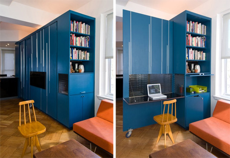 The unfolding apartment utilizes it's space to be an office, library, bedroom, and living room.