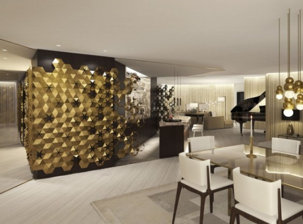 A bronze wall feature and chandelier provide interest and style to this elegant space.