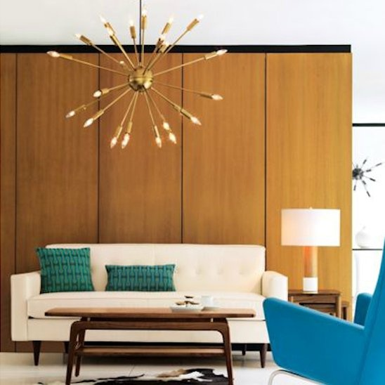 The bronze sputnik is highlighted by the warm, natural woods.