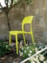Bright, yellow gypsy chair is perfect for any outdoor space.