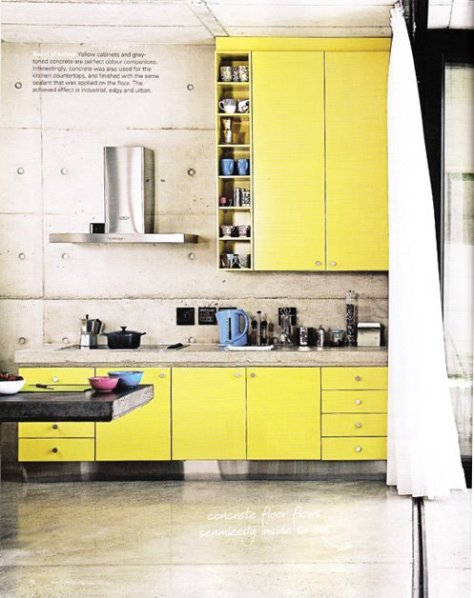 A bold move that shows creativity and style.  These yellow cabinets add vibrance and warmth to the industrial features of the kitchen.