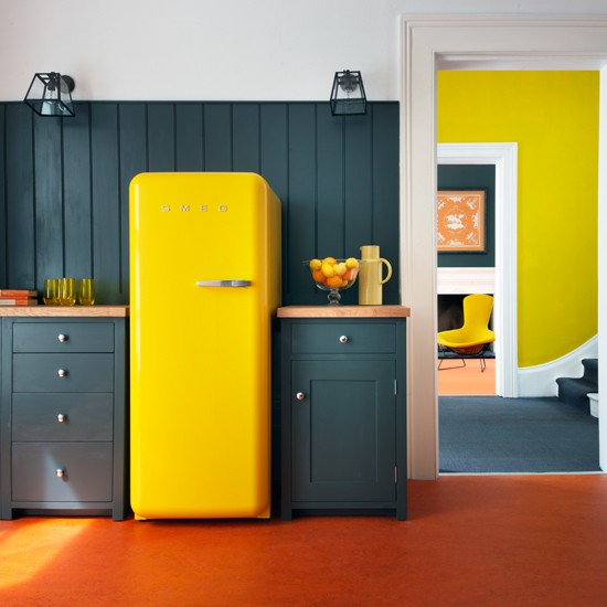 This kitchen created an entirely different feel using neutral cabinets and a fun, yellow refrigerator.