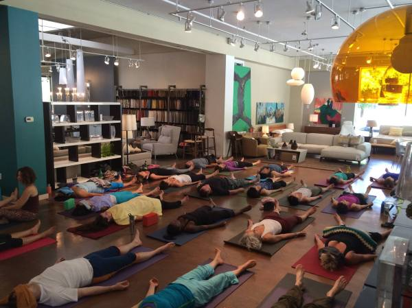 Vinyasa surrounded by beautiful modern furniture couldn't be better.