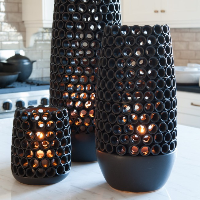 Rollo vases that glow with tea lights.